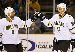 December 11, 2009; San Jose, CA, USA; Dallas Stars center Mike Ribeiro (63) celebrates with defenseman Trevor Daley (6) after scoring a goal against the San Jose Sharks during the first period at HP Pavilion. Dallas defeated San Jose 3-2 in the 11th round of a shootout. Mandatory Credit: Jason O. Watson / US PRESSWIRE