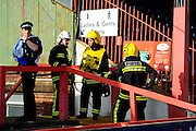 Main stand evacuated - Fire service checking the main stand after smoke was spotted leading to the stand to be evacuated during the Sky Bet League 2 match between Exeter City and Carlisle United at St James' Park, Exeter, England on 12 March 2016. Photo by Graham Hunt.
