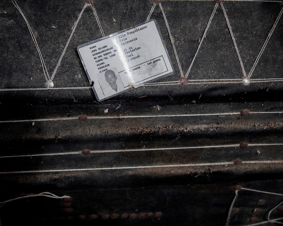 An ID card of a dead relative is placed on the coffin.<br />