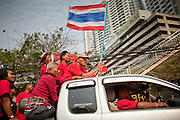 Mar. 28, 2010 - BANGKOK, THAILAND: A pickup truck full of Red Shirt protestors heads for the 11th Infantry Regiment barracks in Bangkok Sunday. More than 10,000 anti government Red Shirt protestor picketed the entrance to the Royal Thai Army's 11th Infantry Regiment Sunday in a continuation of protests that started March 21. The Red Shirts won a key victory Sunday when Thai Prime Minister Abhisit Vejjajiva agreed to negotiate with the protest leaders. The Red Shirts support former Prime Minister Thaksin Shinawatra, who was deposed in a coup in 2006 and went into exile rather than go to prison after being convicted on corruption charges. Thaksin is still enormously popular in rural Thailand. PHOTO BY JACK KURTZ