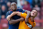 Uche Ikpeazu (#19) of Heart of Midlothian and Tom Aldred (#5) of Motherwell FC tussle during the Ladbrokes Scottish Premiership match between Motherwell and Heart of Midlothian at Fir Park, Motherwell, Scotland on 15 September 2018.