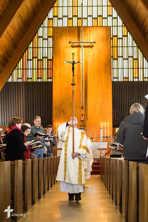 The Rev. Michael Salemink, executive director of Lutherans For Life, carries the crucifix through the nave at the end of the Pre-March For Life Divine Service at Immanuel Evangelical-Lutheran Church in Alexandria, Va., on Friday, Jan. 22, 2016. Michael Schuermann for LCMS Communications