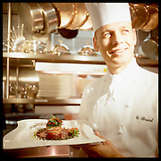 """Chef Guillaume Brard photographed in Cleveland, Ohio, at the InterContinental Hotel's """"Classics,"""" now """"Table 49."""" Brard is now Executive Chef at """"Nine Beaches"""" in Bermuda. Brard earned Classics a AAA Five-Diamond rating."""