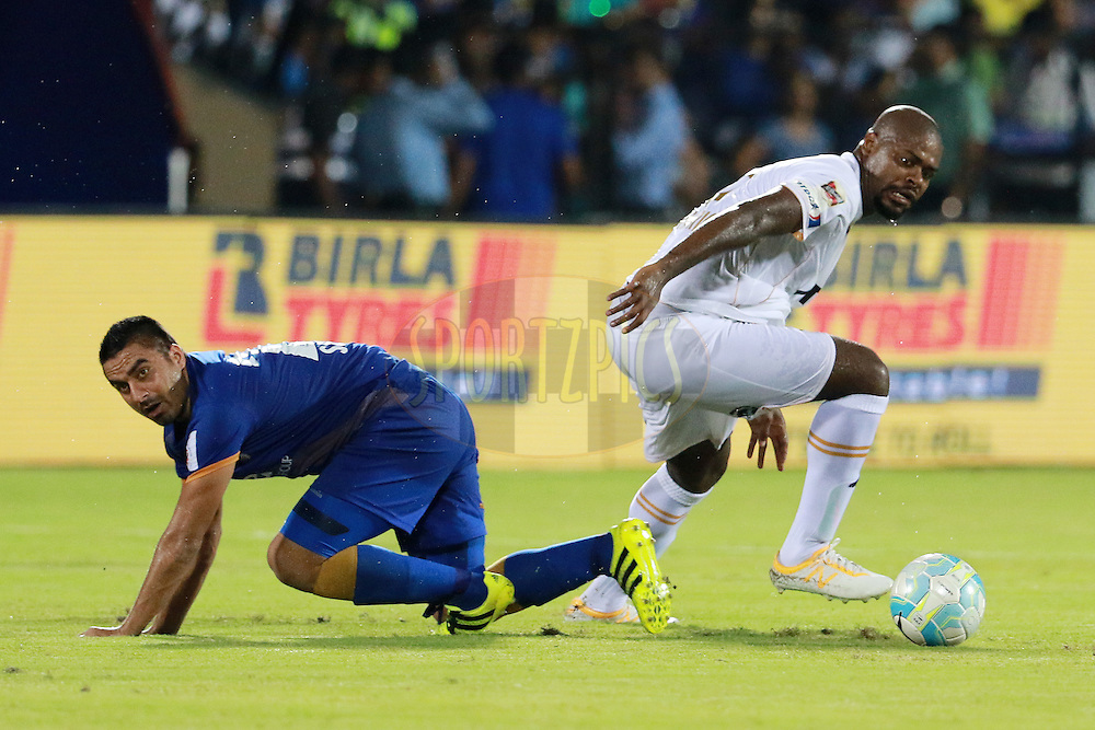 Sehnaj Singh of Mumbai City FC and Romaric of NorthEast United FC in action during match 7 of the Indian Super League (ISL) season 3 between Mumbai City FC and NorthEast United FC held at the Mumbai Football Arena in Mumbai, India on the 7th October 2016.<br /> <br /> Photo by Vipin Pawar / ISL/ SPORTZPICS