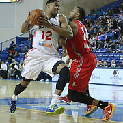 Delaware 87ers Forward Ronald Roberts (12) drives towards the basket as Rio Grande Valley Vipers Forward Akil Mitchell (24) defends in the first half of a NBA D-league regular season basketball game between the Delaware 87ers and the Rio Grande Valley Vipers (Houston Rockets) Saturday, Dec. 27, 2014 at The Bob Carpenter Sports Convocation Center in Newark, DEL