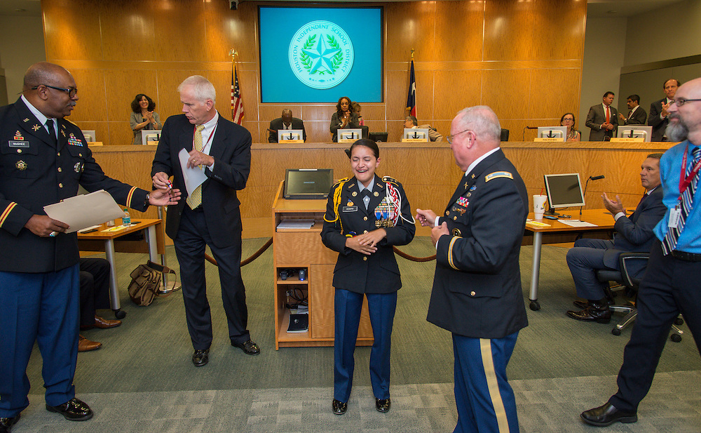 Bellaire High School JROTC cadet Natalie Romero is awarded the Legion of Valor Bronze Cross for outstanding achievement during a Board of Trustees meeting, September 10, 2015.