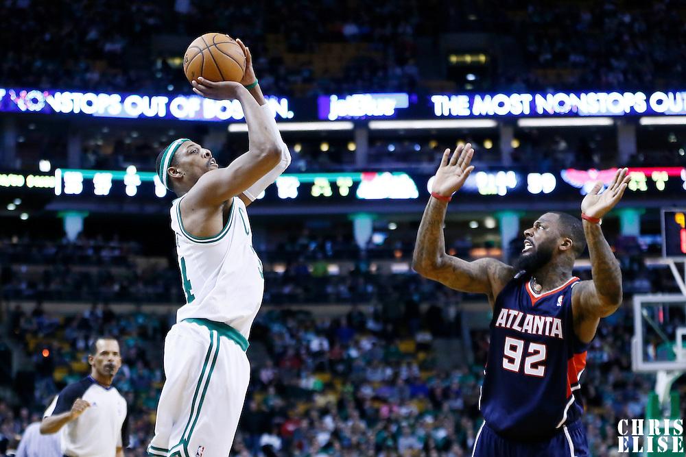 29 March 2013: Boston Celtics small forward Paul Pierce (34) takes a jumpshot over Atlanta Hawks small forward DeShawn Stevenson (92) during the Boston Celtics 118-107 victory over the Atlanta Hawks at the TD Garden, Boston, Massachusetts, USA.
