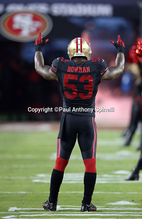 San Francisco 49ers inside linebacker NaVorro Bowman (53) raises his arms during the 2015 NFL week 1 regular season football game against the Minnesota Vikings on Monday, Sept. 14, 2015 in Santa Clara, Calif. The 49ers won the game 20-3. (©Paul Anthony Spinelli)