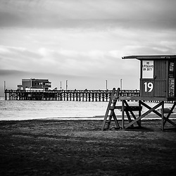 Newport Beach picture of Newport Pier and lifeguard tower 19 black and white photo. Newport Pier is on Balboa Peninsula in Orange County Southern California.