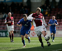 Photo: Marc Atkins.<br /> <br /> Northampton Town v Rochdale. Coca Cola League 2. 08/04/2006. Northampton Town's Martin Smith (R) is chased down by Rochdale's Martin Smith