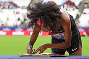 Sifan Hassan of the Netherlands signs the Millicent Fawcett book during the Muller Anniversary Games, Day Two, at the London Stadium, London, England on 22 July 2018. Picture by Martin Cole.
