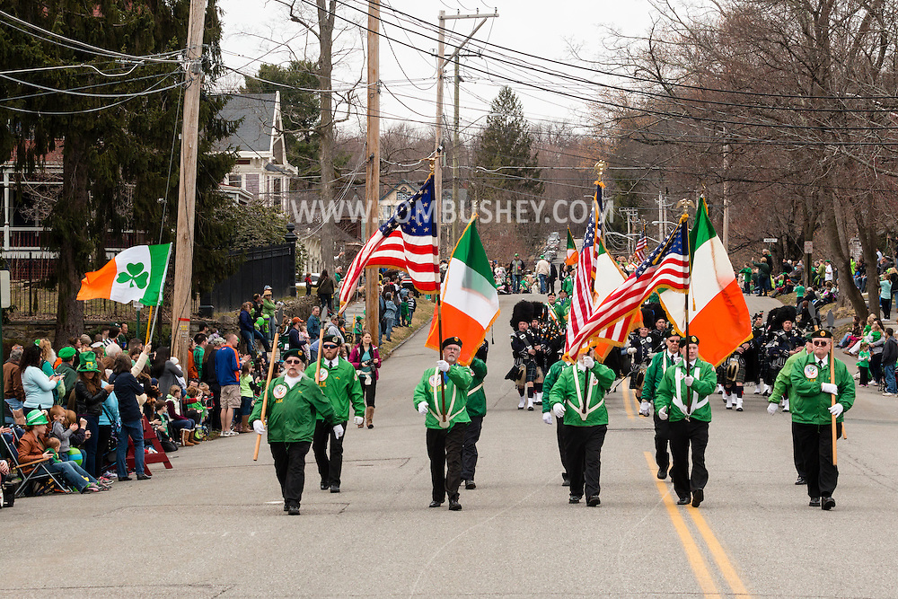 Goshen, New York - Members of the Ancient Order of Hibernians march down North Church Street during the 40th annual Mid-Hudson St. Patrick's Parade on March 13, 2016.
