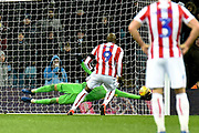 Stoke City striker (on loan from Wolverhampton Wanderers) Benik Afobe (9) scores a goal from the penalty spot  1-2 during the EFL Sky Bet Championship match between Aston Villa and Stoke City at Villa Park, Birmingham, England on 15 December 2018.
