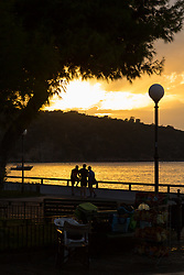 Sorrento, Italy, September 16 2017. A group of people watch the sunset in Sorrento, Italy. © Paul Davey