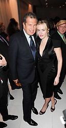 KATE WINSLET and MARIO TESTINO at a party to celebrate Lancome's 10th anniversary of sponsorship of the BAFTA's in association with Harper's Bazaar magazine held at St.Martin's Lane Hotel, London on 19th February 2010.