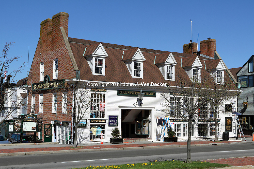 A building marking the entrance to Bannister's Wharf which hosts restaurants and shops on the waterfront in Newport, Rhode Island, USA