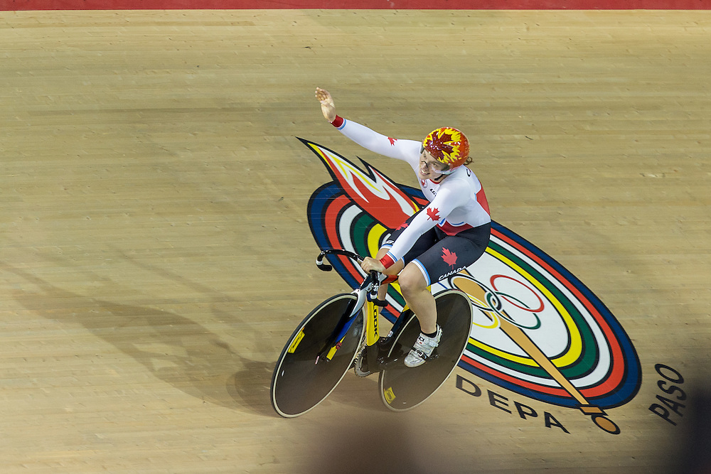 Monique Sullivan of Canada celebrates her team's gold medal win over Cuba in the women's team sprint at the 2015 Pan American Games in Toronto, Canada, July 16,  2015.  AFP PHOTO/GEOFF ROBINS