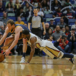 Mar 11, 2018; New Orleans, LA, USA; Utah Jazz forward Joe Ingles (2) and New Orleans Pelicans forward E'Twaun Moore (55) scramble for a loose ball during the first half at the Smoothie King Center. Mandatory Credit: Derick E. Hingle-USA TODAY Sports