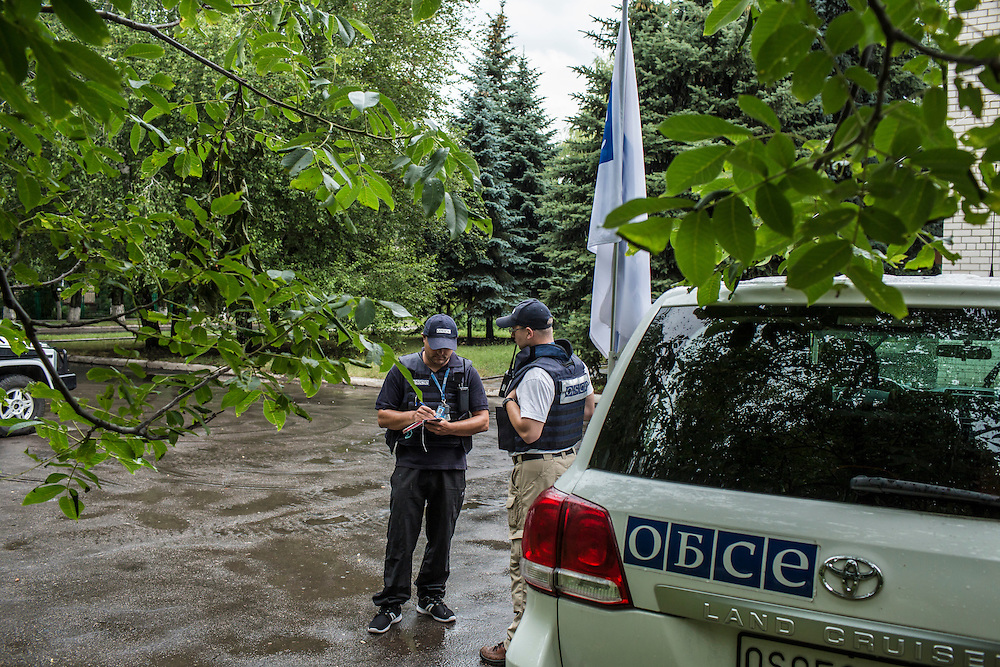 AVDIIVKA, UKRAINE - JULY 10, 2016: Team patrol leader Mitko Simeonov of Bulgaria, left, and monitoring officer Ireneusz Julia Pacocha of Poland, conduct a monitoring mission for the OSCE in Avdiivka, Ukraine. The mission tracks violations of the Minsk-II ceasefire agreement, among other tasks. CREDIT: Brendan Hoffman for The New York Times