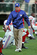 OAKLAND, CA - DECEMBER 31:  Head Coach Tom Coughlin of the New York Giants surveys his team before the game against the Oakland Raiders at McAfee Coliseum on December 31, 2005 in Oakland, California. The Giants defeated the Raiders 30-21. ©Paul Anthony Spinelli *** Local Caption *** Tom Coughlin