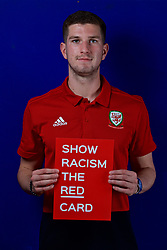 CARDIFF, WALES - Tuesday, October 9, 2018: Wales' Chris Mepham holds a Show Racism The Red Card sign during a media session at the St Fagans National Museum of History ahead of the International Friendly match between Wales and Spain. (Pic by David Rawcliffe/Propaganda)