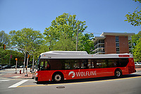 Wolfline bus waits to turn onto Hillsborough Street next to North Hall.