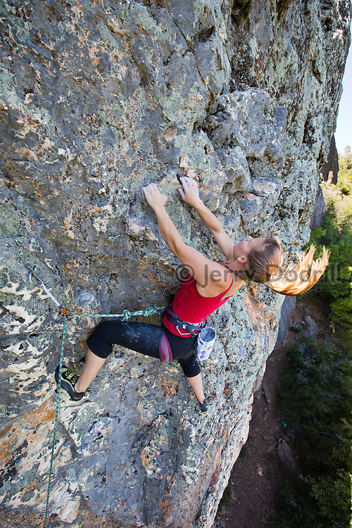 "Sarah McKay climbing ""Black hole Sun"", a 5.11d sport climb at the Bear Cliff on Mt. St. Helena in Robert Louis Stevenson State Park near Calistoga, California."