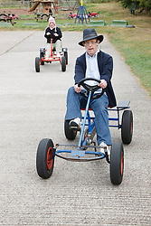 People with learning disability riding go-carts on visit to farm