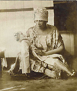 Woman with doll.<br /> Sally Hulugalle Collection.