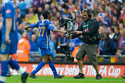 LONDON, ENGLAND - Saturday, May 17, 2008: Portsmouth's match-winner Nwankwo Kanu celebrates in front of a television camera during the FA Cup Final at Wembley Stadium. (Photo by David Rawcliffe/Propaganda)