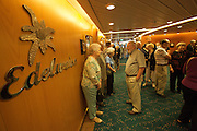 Aboard the Rhapsody of the Seas, on a cruise from Vancouver to Hawaii. Passengers waiting for the Edelweiss restaurant to open.