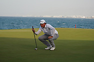 Sami Valimaki (FIN) lines up his winning putt during Round 4 of the Oman Open 2020 at the Al Mouj Golf Club, Muscat, Oman . 01/03/2020<br /> Picture: Golffile | Thos Caffrey<br /> <br /> <br /> All photo usage must carry mandatory copyright credit (© Golffile | Thos Caffrey)