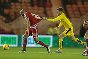 Burnley midfielder David Jones  holds onto Middlesbrough midfielder Emilio Nsue  during the Sky Bet Championship match between Middlesbrough and Burnley at the Riverside Stadium, Middlesbrough, England on 15 December 2015. Photo by Simon Davies.