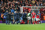 Pitch invaders celebrate with Charlton Athletic after winning the match 4-3 on penalties during the EFL Sky Bet League 1 second leg Play-Off match between Charlton Athletic and Doncaster Rovers at The Valley, London, England on 17 May 2019.