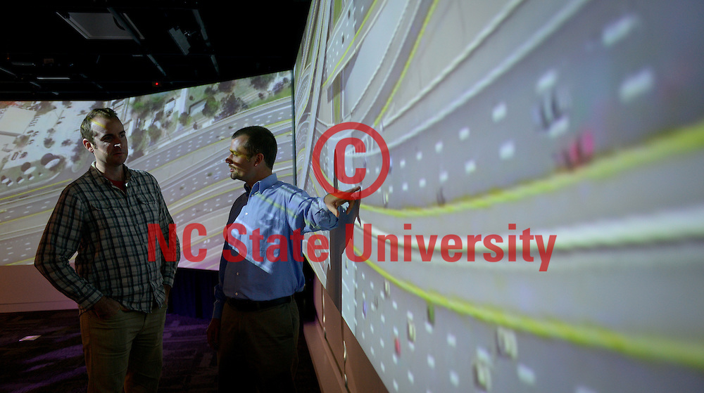 Dr. Bastian J. Schroeder, of the Institute for Transportation Research and Education (ITRE) at North Carolina State University, looks at a civil engineer project in the Teaching and visualization lab in the Hunt Library. Photo by Marc Hall