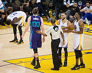 Golden State Warriors guard Stephen Curry (30) and forward Andre Iguodala (9) laugh with Charlotte Hornets forward Spencer Hawes (00) as Golden State Warriors forward Draymond Green (23) doubles over in shoulder pain during the second quarter at Oracle Arena in Oakland, Calif., on February 1, 2017. (Stan Olszewski/Special to S.F. Examiner)
