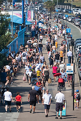 © Licensed to London News Pictures. 31/07/2020. Southend, UK. Visitors walk along Southend-on-Sea promenade as social distancing measures are relaxed and temperatures are expected to be over 30c. British holiday makers have chosen to book staycations in the UK as the uncertainty of Covid-19 lockdown looms. Photo credit: Ray Tang/LNP