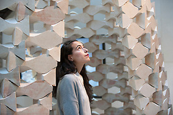 "© Licensed to London News Pictures. 15/09/2017. London, UK. A staff member stands in front of ""While We Wait"" by Palestinian architects Elias and Yousef Anastas at the V&A museum in Kensington.  This work forms part of the London Design Festival, a programme of events and installations celebrating design taking place across the capital 16-24 September 2017.  Photo credit : Stephen Chung/LNP"