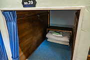 """Dorm bed alcoves. The comfortable Tokusawa-en mountain hut is an easy walk of 7.5 km with 100 meters gain from Kamikochi. Kamikochi (""""Upper Highlands"""") is a high valley within the Hida Mountains, in Chubu-Sangaku National Park, Nagano Prefecture, Japan. Last logged in the mid 1800s, it is now a popular nature resort. Embraced within the """"Northern Alps"""" of the Japanese Alps, the valley floor ranges from 1400 m (4600 ft) to 1600 m (5200 ft) elevation. Its highest peak is Okuhotakadake (3190 m or 10,470 ft)."""