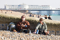 Brighton, UK. 23/10/2016, Members of the public dress up warm with scarfs and hats to spent the day on the beach in Brighton. Photo Credit: Hugo Michiels
