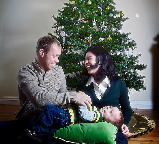 Sharing some laughs by the Christmas Tree. A Holiday Season Family Portrait.