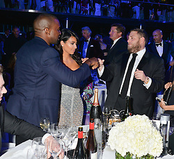 Left to right, KANYE WEST KIM KARDASHIAN and JONAH HILL at the GQ Men Of The Year 2014 Awards in association with Hugo Boss held at The Royal Opera House, London on 2nd September 2014.