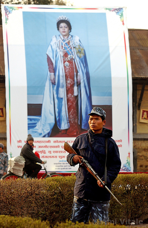 A soldier stands guard in front of a poster of Queen Komal as thousands of people arrive to celebrate Democracy Day and to greet  the Queen who was marking her 55th birthday in Kathmandu, Nepal February 18, 2005.  Nepal marked its annual Democracy Day under emergency rule with severe press censorship, telephones cut and streets flooded with security forces.  King Gyanendra got rid of the government and declared emergency rule on February 1 saying that the country  is under threat from Maoist rebels and political instability.  The Maoist insurgency has claimed over 11,000 lives since 1996. (Ami Vitale)