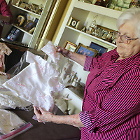 Dot Wagnon displays an angel gown, burial clothing made by volunteers to meet the needs of families who lose infants.