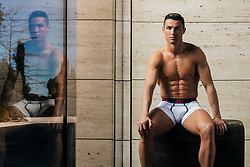 "Cristiano Ronaldo strips down to his smalls in a new photoshoot showcasing his latest underwear line. The 33-year-old Real Madrid star cuts a dash in some choice selections from his vibrant CR7 Spring/ Summer 2018 underwear collection. Looking tanned and sculpted, the football star flexed his muscles in a bold at-home shoot, giving fans a glimpse behind closed doors. Talking about the shoot, Ronaldo explained: ""Underwear is incredibly intimate and I wanted to showcase this collection in the environment that is most intimate for me - so shooting at home felt like the natural choice. ""I love the campaign that we created, I was able to really relax on the shoot and I think you can see that in the photos."" Ronaldo's CR7 Underwear brand launched in 2014 and this marks the sportsman's ninth collection. The underwear is produced by a 75-year-old Danish company called JBS Textile Group. Commenting on the new designs, Ronaldo added: ""I choose different CR7 Underwear styles depending on how I feel each morning, so with each collection I like to design contrasting patterns and colorways to make sure there's an option for any occasion. ""The Spring/Summer 18 CR7 Underwear range includes timeless white silhouettes for a classic look and bold blue and even pinks for when you want to be more adventurous. I love the styles with touches of vibrant colour. To me, that is luxury!"" The Spring/Summer 2018 CR7 Underwear collection is available now from www.CR7Underwear.com and select retailers worldwide. 12 Mar 2018 Pictured: Cristiano Ronaldo poses for his Spring/ Summer 2018 CR7 Underwear campaign in an at-home photoshoot. Photo credit: CR7 Underwear/ MEGA TheMegaAgency.com +1 888 505 6342"