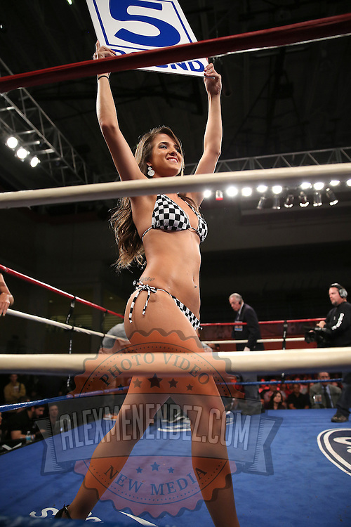 "A ring girl holds up the round card during the ""Boxeo Telemundo"" boxing match at the Kissimmee Civic Center on Friday, March 14, 2014 in Kissimmme, Florida. (Photo/Alex Menendez)"