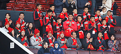 The 12 boys who were trapped in a cave in Thailand with their football coach earlier this year in the stands before the Premier League match at Old Trafford, Manchester.
