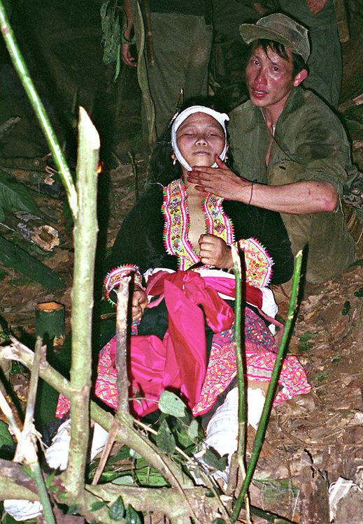 Mrs. Lou Her, 30 years old, killed April 6, 2006... ..Pictured are a group of Hmong people who report an attack against them April 6, 2006 by Lao and Vietnamese military forces.  26 people perished, 5 were injured, and 5 babies died shortly after because their dead mothers could not breast-feed them.  Only one adult male was killed, the other 25 victims were women and children (17 children).