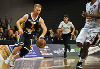 Hayden Allen runs up the court, in the NBL match, between the Otago Nuggets and Hawkes Bay, Lion Foundation Arena, Edgar Centre, Dunedin, Otago, New Zealand, Friday, May 24, 2013. Credit: Joe Allison / Allison Images.