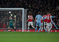 Football - 2019 /2020 FA Cup - Third Round: Arsenal vs. Leeds United.<br /> <br /> Patrick Bamford (Leeds United), hidden, forces Emiliano Martínez (Arsenal FC) into a smart save as he strikes from close range at the Emirates Stadium<br /> <br /> COLORSPORT/DANIEL BEARHAM